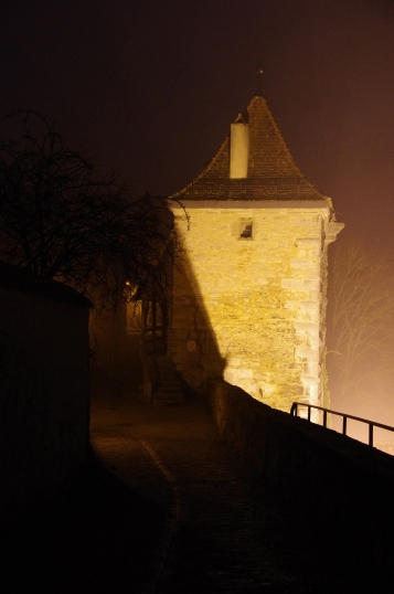 Rothenburg ob der Tauber, Germany - Christmas 2016. The walls are deserted at night. The mist gives the place a really creepy feel but we loved it.